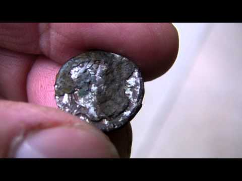 Cleaning a Roman silver coin covered in silver oxide
